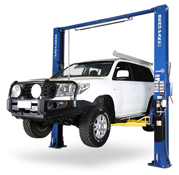 A 4WD vehicle on a workshop hoist